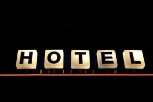 8875211 - illuminated hotel sign against black background